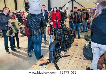 St. Petersburg Russia - 15 April, Visitor with children at the motor depot,15 April, 2017. International Motor Show IMIS-2017 in Expoforurum. Visitors and participants of the annual moto-salon in St. Petersburg.