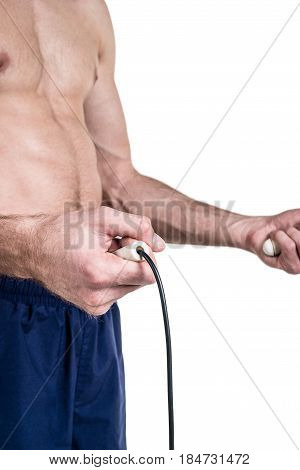 Healthy Lifestyle And Fitness. Naked Body Of A Sporty Guy With A Skipping Rope In Hands, Isolated On