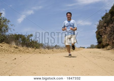 Man Jogging On Dirt Path