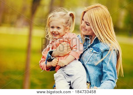 Happy Family Moments. Mum And Daughter Enjoying Their Free Time Im Park.