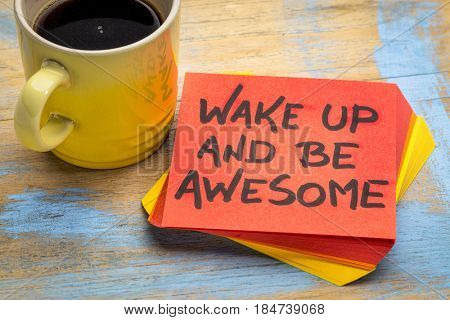 wake up and be awesome - motivational advice on a sticky note with a cup of coffee