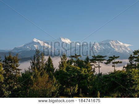 POKHARA, NEPAL. The Himalayas, North of Annapurna on the background of blue sky.
