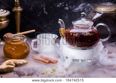 Black Indian tea and the Chinese Pu-erh with addition of an anisetree, cardamom, cinnamon, clove, ginger and black pepper. Tea is served with honey and milk