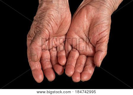Senior woman wrinkled hands. Palms up. Isolated on black clipping path included