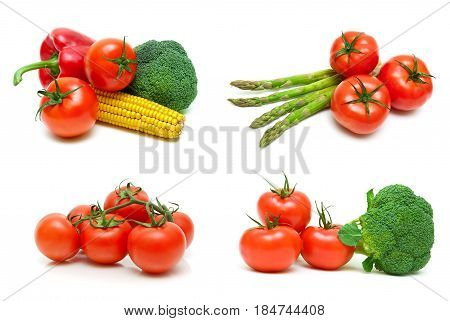 Ripe tomatoes and other vegetables on a white background. Horizontal photo.