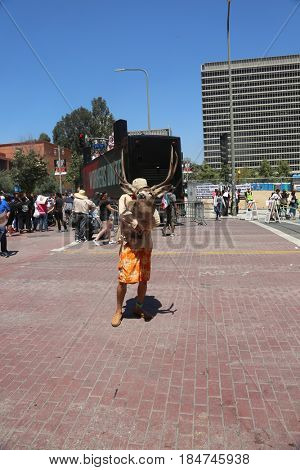 LOS ANGELES California- May 1, 2017: May Day Protest, Wave Signs, Chant, Cheer, and Demand Change at a Rally Against President Donald J. Trump on May 1, 2017 in Los Angeles, California.