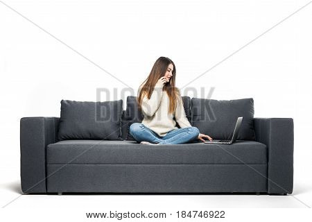 Happy Pretty Woman Using Laptop Sitting On Sofa