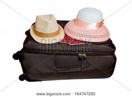 Suitcase and hats isolated on white background