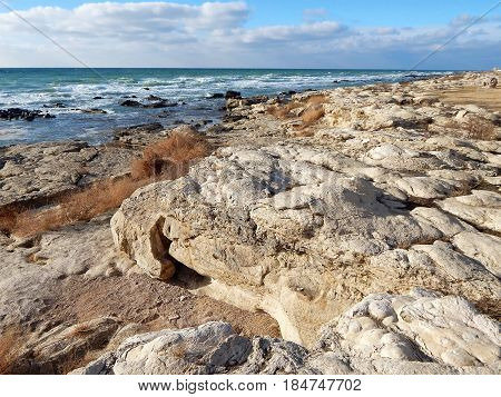 Rocky shore of the Caspian Sea. Month January.