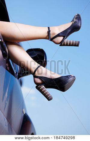 Legs In Car Window
