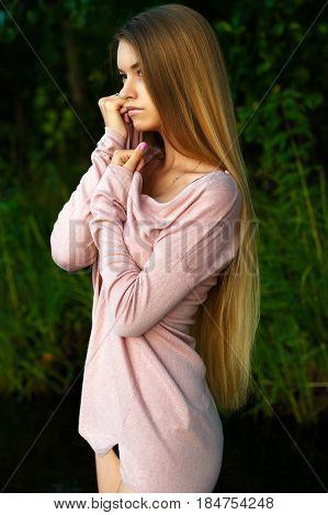 femininity girl teenager with luxurious long hair