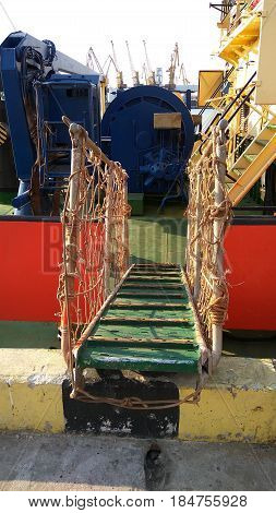In the port a wooden gangway from the dock to the tow