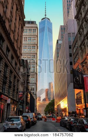Beautiful sunset in New York City and One World Trade Center from the street on June 26, 2016 in New York City, Manhattan.