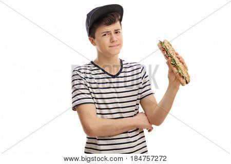 Displeased teenager holding a sandwich isolated on white background