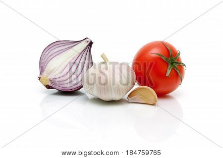 Garlic onion and tomato on a white background. Horizontal photo.