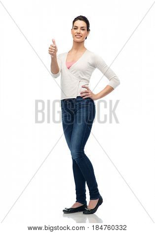 gesture, fashion, portrait and people concept - happy smiling young woman in cardigan and jeans showing thumbs up over white