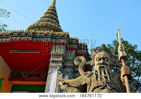 Ancient Temple complex of Buddhism, striking with its exquisite architectural beauty and architecture of the building, the temple is decorated with flowers, secret signs. The mystical guard threatens to guard the entrance to the altar. Holy symbols and dr