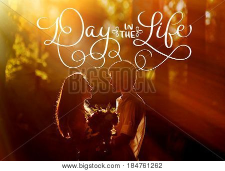 Young loving couple kissing in the evening in the park and text Day in the life. Calligraphy lettering vintage hand draw.