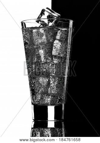 Glass Of Mineral Carbonated Water With Ice.black And White Background