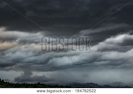 Long shot view of stormy clouds sky over mountain range