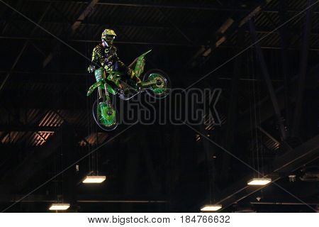 St. Petersburg Russia - 15 April, Biker in the jump above the ceiling,15 April, 2017. International Motor Show IMIS-2017 in Expoforurum. Moto show at the St. Petersburg moto salon.
