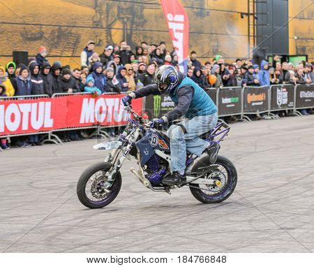 St. Petersburg Russia - 15 April, Biker on motobike,15 April, 2017. International Motor Show IMIS-2017 in Expoforurum. Sports motorcycle show of bikers on the open area.