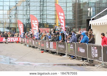 St. Petersburg Russia - 15 April, The spectators are at the fence,15 April, 2017. International Motor Show IMIS-2017 in Expoforurum. Sports motorcycle show of bikers on the open area.