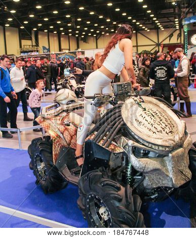 St. Petersburg Russia - 15 April, The girl on the ATV,15 April, 2017. International Motor Show IMIS-2017 in Expoforurum. Models on motorcycles presented at the motor show.