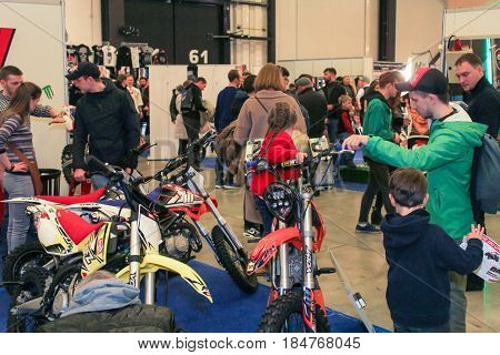 St. Petersburg Russia - 15 April, Visitors and motorcycles,15 April, 2017. International Motor Show IMIS-2017 in Expoforurum. Visitors and participants of the annual moto-salon in St. Petersburg.