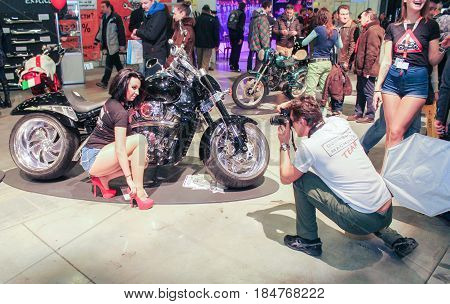 St. Petersburg Russia - 15 April, Photoshoot at the motor show,15 April, 2017. International Motor Show IMIS-2017 in Expoforurum. Models on motorcycles presented at the motor show.