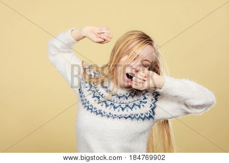 Sleepy Yawning Teenage Woman In Jumper