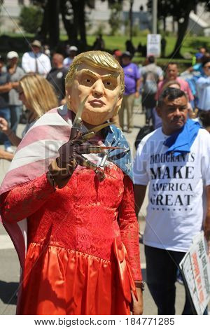 LOS ANGELES California- May 1, 2017: May Day People Wave Signs, Wear Costumes, Yell, Demand Change at a Protest Rally Against President Donald J. Trump on May 1, 2017 in Los Angeles, California.