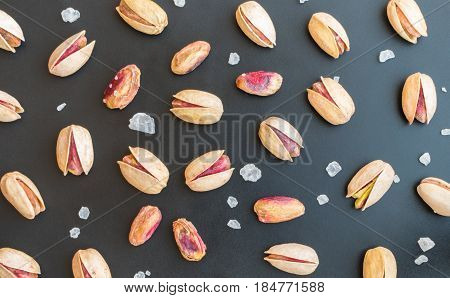 Set Of Single Inshell Pistachios And Peeled Pistachios With Large Salt Crystals