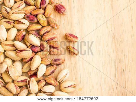 Pistachios In A Wooden Board