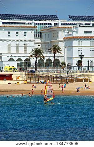 CADIZ, SPAIN - SEPTEMBER 8, 2008 - Windsurfer with La Caleta beach to the rear Cadiz Cadiz Province Andalusia Spain Western Europe, September 8, 2008.