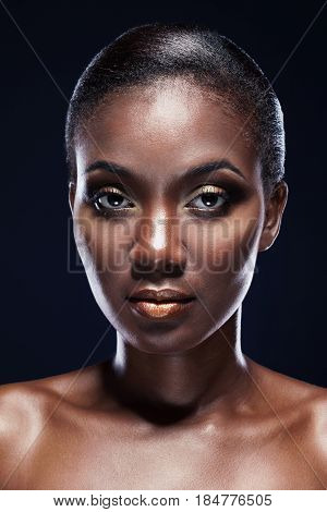 Beauty portrait of handsome African American woman. Studio portrait on dark background