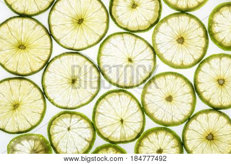 Bright Citrus Lime Slices On White