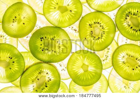 Transparent Kiwi Slices On White Luminous Background