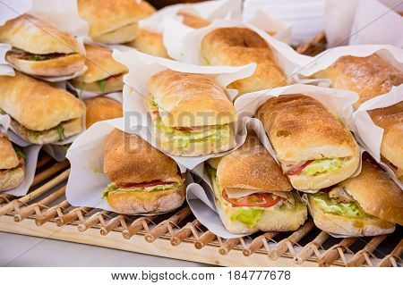 Close up pile of sanwiches for sale for background texture