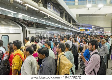 INDIA, NEW DELHI - APRIL 5, 2017: Commuters travelling by metro in New Delhi on the 5th of april 2017