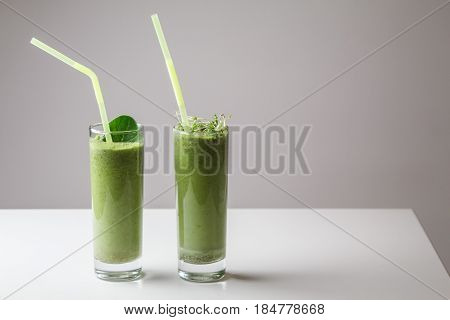 Freshly Blended Green Fruit Smoothie In Glass With Straw. Theme Of Raw Food, Live Food, Healthy Eati