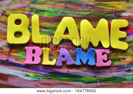 word blame on a  abstract colorful background