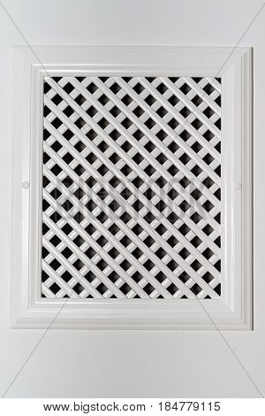 Close-up photograph of white plastic ventilation grate