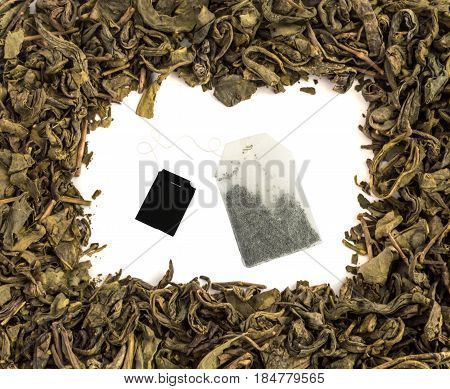 Dry Green Tea Leaves And Tea Bags Background