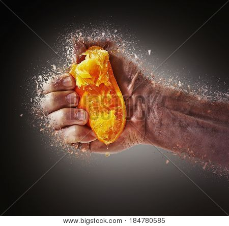 Fresh Squeezed Orange Juice by male hand and juice falling shattered