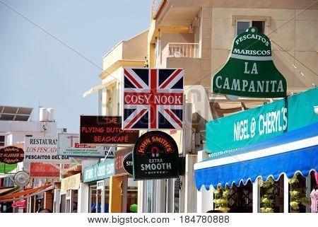 TORREMOLINOS, SPAIN - SEPTEMBER 3, 2008 - Bar and shop signs along the promenade Torremolinos Malaga Province Andalusia Spain Western Europe, September 3, 2008.