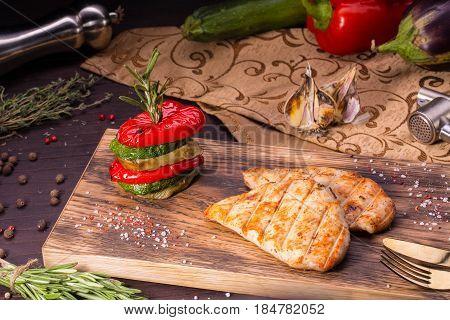 The chicken fillet made on a grill with paprika, a vegetable marrow and an eggplant