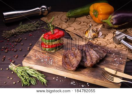 A medallion from juicy beef sirloin with an eggplant, a vegetable marrow and paprika, prepared on a grill