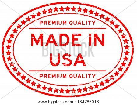 Grunge red premium quality made in USA oval rubber seal stamp on whtie background