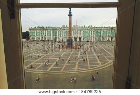 View through the window to the Palace Square, the Hermitage and the Alexander Column in Saint Petersburg, Russia - July 2016